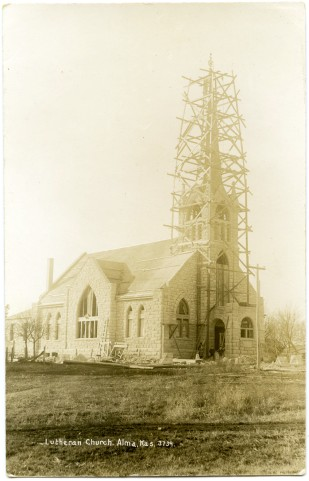 The new St. John Lutheran Church was under construction when this 1908 real photo postcard image was taken. Notice that the windows had not been installed, nor the spires along the roofline. Photo Courtesy St. John Lutheran Church.