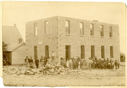 August Zeckser and his crew constructed the St. John Lutheran School in the summer of 1890 and are seen here with a group of onlookers. The masonry work for the new building cost $895.60. Photo Courtesy St. John Lutheran Church.