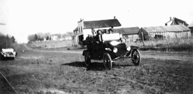 A touring car passes through Keene, Kansas on Kansas Highway 4 in this photo circa, 1920. Photo Courtesy Ida Thomas.