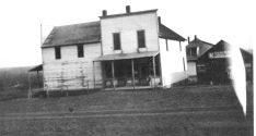 The Keene Store opened at the intersection of K-4 Highway and Bradford Road in 1874. Notice in this view that when this photo was taken the store was two stories and had full storefront on the east side of the building as well as the north side. An early blacksmith shop is visible at the right. When this photo was taken, the road was still mud and the store had no gas pumps. Photo Courtesy Ida Thomas.
