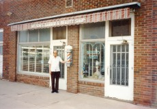 Bat Nelson stands in front of his barbershop in Alta Vista, Kansas in this view from the 1980s. Photo courtesy Michael Stubbs.