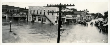 While operating a studio in Burlington, Kansas, Louis Palenske purchased a Korona Panoramic View Camera which used 17 and 20-inch wide film negatives. Palenske used his Korona camera to photograph the flood waters of the Neosho River at Burlington on September 12, 1926.