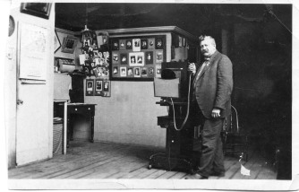Gus Meier is photographed with a camera in his studio located at 210 Missouri Street in Alma, Kansas.