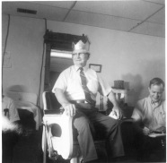 """Maple Hill, Kansas barber Wilber """"Jack"""" Herron sits on his barber chair as Maple Hill residents congratulate him on his 90th birthday in this view dated 1971. Herron operated a barbershop in Maple Hill for more than 60 years."""