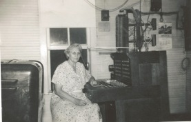 Longtime Maple Hill, Kansas operator, Mable Clark is seated at the switchboard. Photo courtesy Nick Clark.