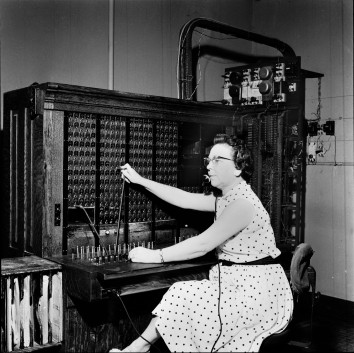 Nola Conrad, longtime telephone operator at Eskridge, Kansas is seen here connecting a call at the switchboard. Photo courtesy Kansas State Historical Society.
