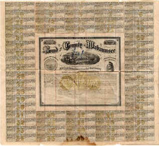 This bond from 1873 was approved by the Wabaunsee County Commissioners for indebtedness to fund the Wabaunsee County portion of the Mill Creek Valley & Council Grove Railway. This bond for $1,000 has coupons which the owner would detach to collect their interest. The bond was cancelled in 1875 when the railroad enterprise failed.