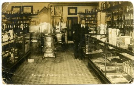 Dr. W. H. H. Smith, right, operated this pharmacy in Alta Vista, Kansas when this 1909 real photo postcard was created.