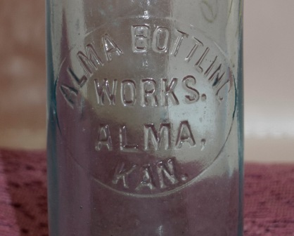 Alma Bottling Works, Alma, Kansas used this bottle for soft drinks in the early 1900s.