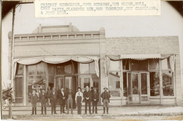 Guy Cleaveland, second from the right, operated the Alma Bottling Works from his feed store building located at 411 Missouri Street in Alma. Here, a group of Alma men stand in front of a cigar store located at 224 Missouri Street.