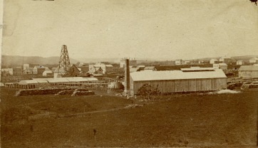 The Alma Salt Works, seen here in 1874, was located, generally, in the 600 block of Grand Street in Alma, Kansas. The derrick from the brine well is clearly visible. In the distance at the far left the first Wabaunsee County Courthouse, the Meyer Store and Peter Degan's Germania Hall are all easily recognizable. Just behind the smokestack at the center is the second Wabaunsee County Courthouse.