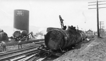 This photograph of the wreckage of tanker cars at Volland, Kansas was probably taken the day after the crash and fire. Notice the railroad wrecker working in the center of the photo.