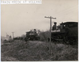 Two locomotives are parked just west of the scene of a derailment and fire of a Rock Island train, near Volland, Kansas. The Volland railroad water tower is visible in the distance.