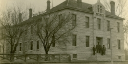 A group of county officials stand on the front steps of the Wabaunsee County Courthouse in this real photo postcard view, circa 1910. The Mullins and Roberts trials were both held in this courthouse.