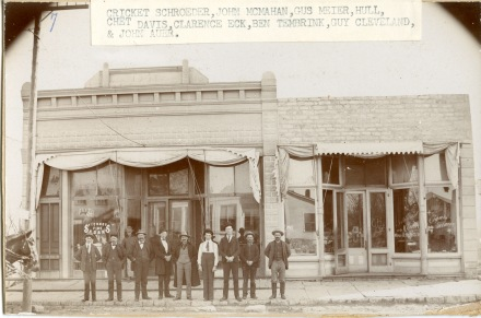 "A group of Wabaunsee County men pose in front of ""Johnnie Mac's"" saloon in Alma, Kansas in this view, circa 1900."