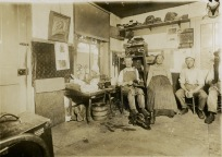 Ferdinand Herrmann, Christine Herrmann, and Fred Herrmann are seen in this Gus Meier interior view of their shoe shop in Alma, dated 1912.