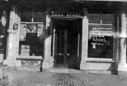 E. R. Brown owned this drug store in Eskridge, Kansas when fire swept through the downtown on March 15, 1914, destroying nine buildings. After Brown rebuilt the store, it sold and became Jewett Drug Store before being purchased by Preston Dunn.