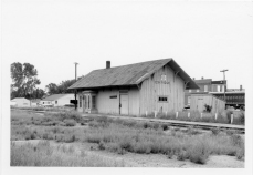 The Atchison, Topeka, & Santa Fe depot at Eskridge, Kansas had gone to seed when Dean Dunn took this photograph in the early 1970s.