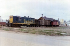 Dean Dunn waited at the Atchison, Topeka, & Santa Fe depot to take this 1972 photograph of the last train departing the Eskridge, Kansas depot as the railroad line was discontinued.