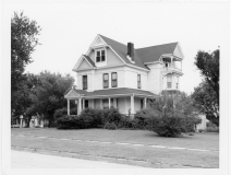 This was the home of Dr. and Mrs. Coffey of Eskridge, Kansas when Dean Dunn photographed it around 1960. The house, located on West 2nd Avenue, was built in the late 1880s for John Clark.