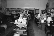 Dunn Home Supply opened on September 9, 1949 as a furniture store. Inez Dunn is seen here in the rear doorway on the store's opening day.