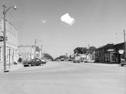 Dean Dunn took this photo of Main Street in Eskridge, looking north in about 1964. Notice that there were three new car dealerships in Eskridge at this time, the Ford dealership at the far left, the Chevrolet dealership, seen at the right, and the Plymouth dealership, located in the next block north.