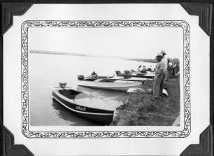 Boat race participants ready themselves for activities at the newly built Lake Wabaunsee in this view from about 1940.