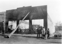The R. C. Day Ford dealership, located at 212 South Main Street in Eskridge fell victim to a fire which gutted the business on February 4, 1921. A telephone pole was propped against the building to prevent the façade from collapsing into the street, and unbelievably, the building's brick face was saved and the structure rebuilt.