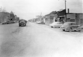 This early 1950s photograph by Dean Dunn looks north on Main Street from 3rd Avenue.