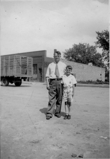 Preston Dunn, left, and Dean Dunn stand on Main Street in this view from the 1930s. Duff Produce is visible in the background.