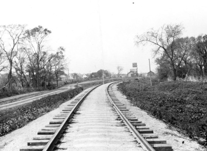 Dean Dunn took this photograph from the Atchison, Topeka, & Santa Fe tracks just east of the Eskridge Co-op and the Eskridge depot, visible in the distance.