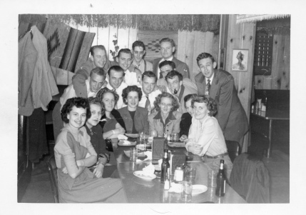 A group of Eskridge residents enjoy an evening at Cap MacKenzie's Lake Wabaunsee Lounge. Inez Dunn is seated third from the right, and Dean is behind her, with a pipe in his mouth.