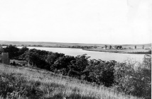 Dean Dunn took this photograph of Lake Wabaunsee from the east arm, looking to the west. The barracks buildings are visible on the north shore.