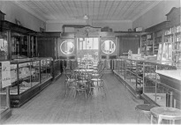 This interior photo of an early pharmacy is likely a view of Preston Dunn's first pharmacy at Harveyville.