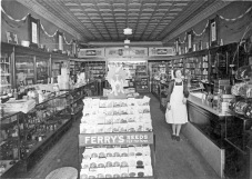 This is an early interior view of Preston Dunn's Rexall Drug Store located at 111 Main Street in Eskridge, Kansas, circa 1935.