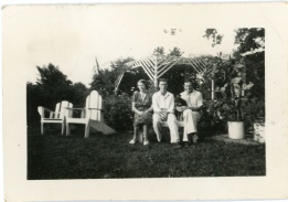 Carl F. Hoots, center, sits with his mother, Marjorie and father, Carl E. Hoots at their home in West Plains, 1939.