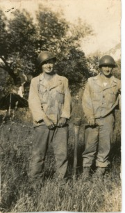 Carl Hoots and Joe Luduma pose with their foxhole-digging pick in Tunisia, North Africa, May, 1943.