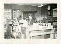 Leland Lucky, manager of the Clinton Scott Lumber Company is seen behind the counter at the lumber company in November of 1943.