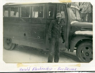 Eskridge Rural High School bus driver, Harold Blankenship stands beside his bus on a snowy day at Eskridge.
