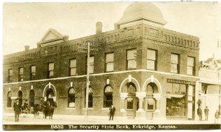This real photo postcard showing the Security State Bank in Eskridge, Kansas dates from about 1907.
