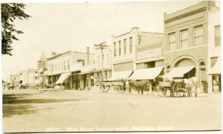 This Zercher Photo real photo postcard from about 1907 shows the west side of Main Street in Eskridge, Kansas, looking south.