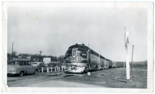 An Atchison, Topeka & Santa Fe Streamliner stops at the Eskridge depot to take schoolchildren on a trip to Kansas City.