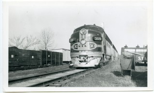 An ATSF Streamliner stops at Eskridge in this 1950s view.