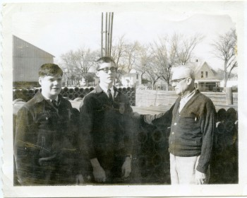 Jim Eastman, left, and Gary Rimby, center, visit with Leland Lucky at the Scott Lumber Company in Eskridge, Kansas.