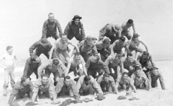 Members of the 3rd Infantry Division train for sea landings on the beaches near Fort Ord, California in 1942. Carl F. Hoots is the third from the left on the third row.