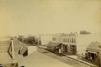 This Gus Meier View, circa 1893, looks to the northeast in the 200 block of Missouri Street. Louis Palenske's Alma State Bank was located in the south side of the Palenske Building, the second building from the right in this view. This would be the first home of the Alma National Bank.