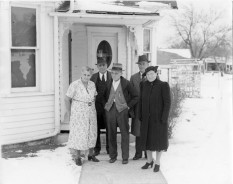 """The Palenske family stand in front of Louis and Emma Palenske's """"retirement house"""", located at 604 Kansas Avenue in Alma, Kansas, in this view, circa 1940. From left, Emma Palenske, Fred Palenske, Louis Palenske, Martin Zwanziger, and Minnie Zwanziger."""