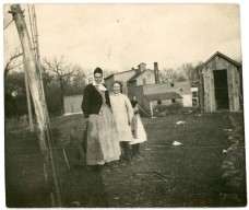 Emma Palenske, left stands with her daughters, Laura, center, and Florence in front of the Alma flour mill, circa 1913. Photo courtesy the Palenske family.