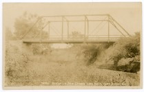 This postcard view the bridge over Mission Creek on Carlson Road was produced by Zercher Book and Stationery, circa 1908.