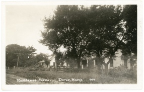 This residential view postcards shows homes on SW 57th Street in Dover, Kansas.